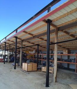 Back view of the new steel mounting structure built through the old shed roof