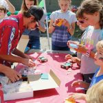 Kids activities included face-painting, bouncy castles, and building model solar cars!