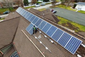 Rooftop solar installer at work