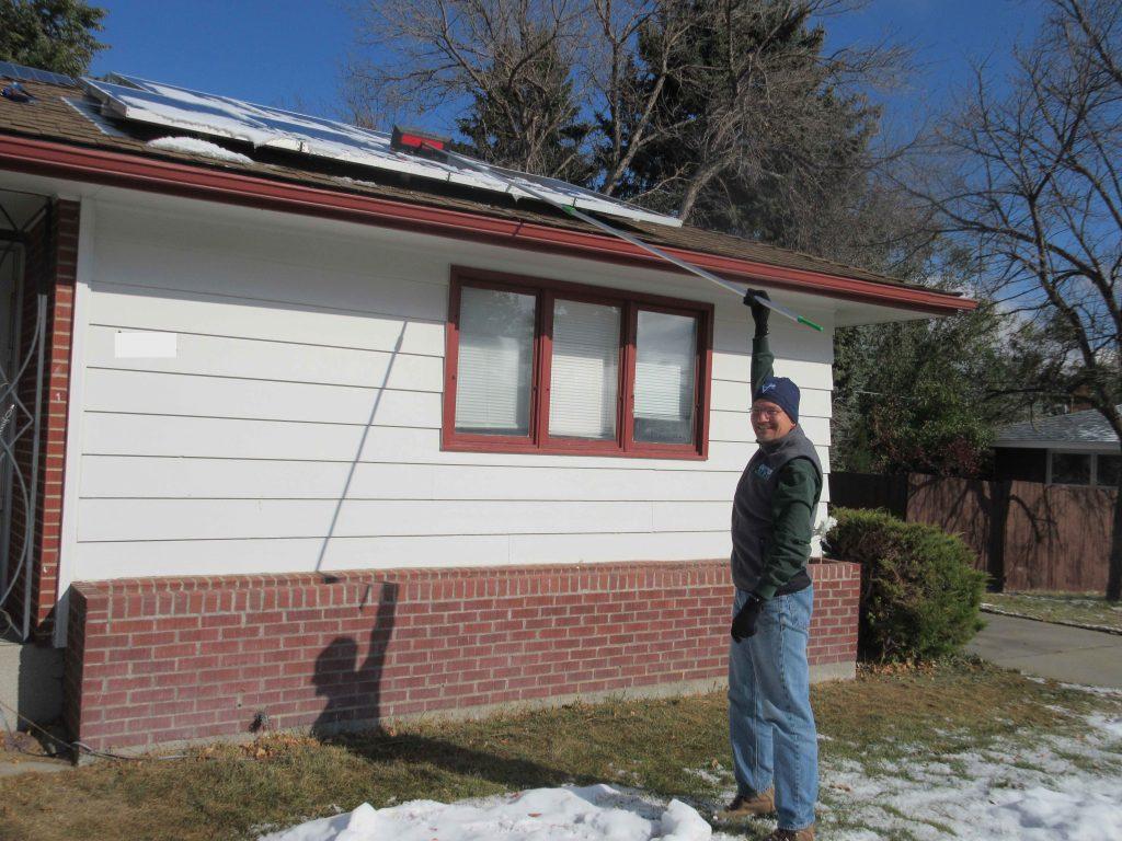 Pat raking snow off of his solar panels