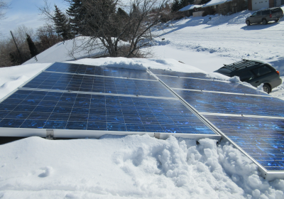 Solar and Snow: To Brush or Not to Brush